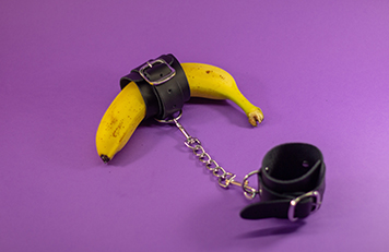 Leather Handcuffs on a banana
