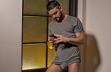 A man wearing comfy lounge shirt and boxer shorts