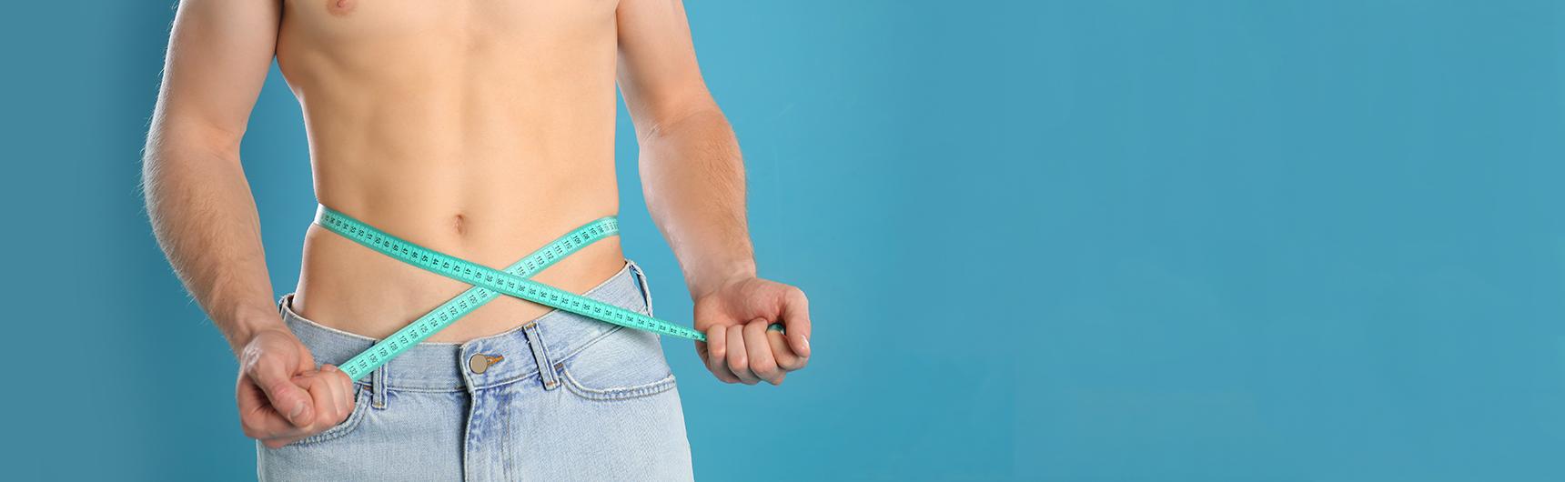 Man measuring waist size